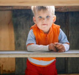 boy with autism under table