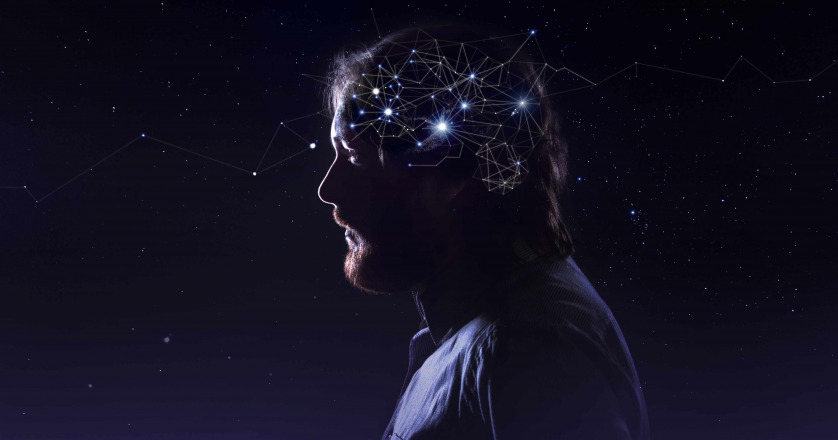 Profile of a bearded man head with symbol neurons in brain