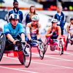 Athletes on wheelchairs in the olympic stadium