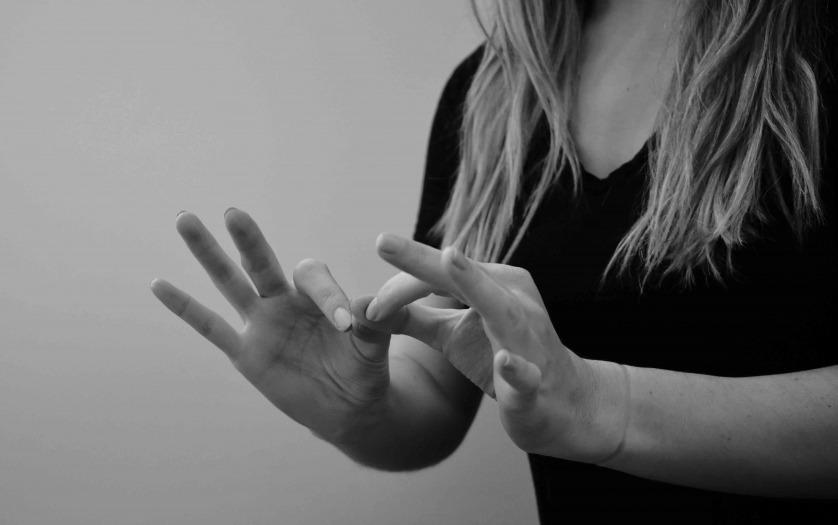 Woman interpreting American Sign Language