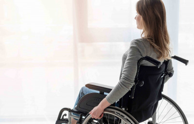 Portrait of women in wheelchair looking away