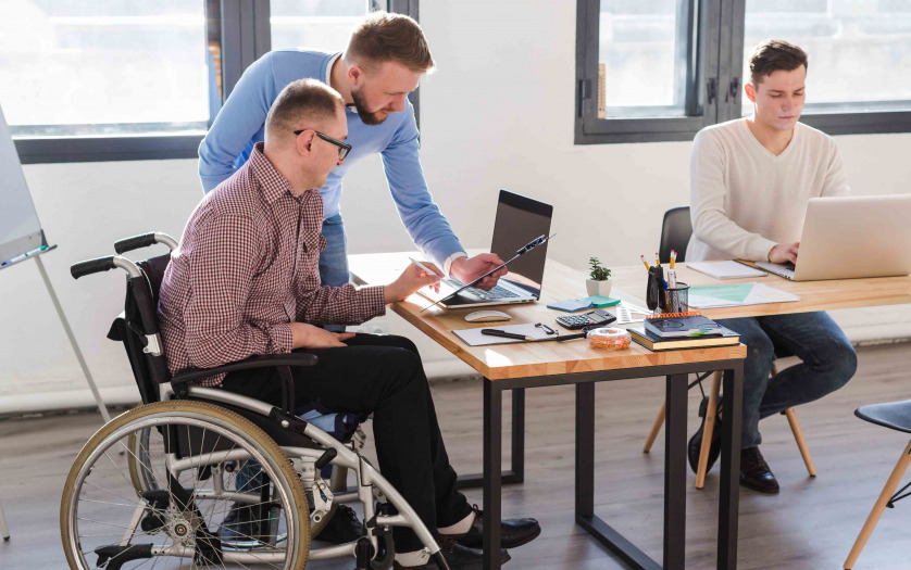 Group of adult men working together at the office