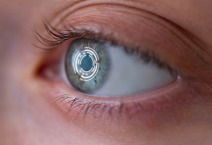 Woman's eye with lens with digital and biometric implants