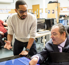 Martez Mott, left, a PhD candidate in the University of Washington's Information School, works on Smart Touch technology with Ken Frye at Provail