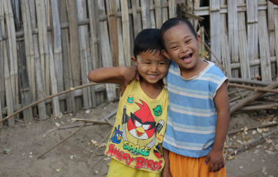 two children plays together One of them has the down syndrome