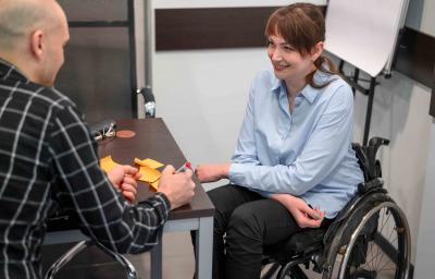 Smiley businesswoman in wheelchair