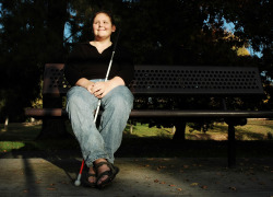 blind woman sitting in the park