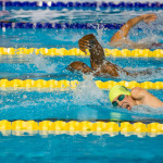 participants gushing through water in swimming competition