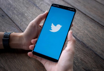 Smartphone with twitter logo on screen