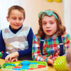 cheerful kids playing together in daycare center for kids with disabilities