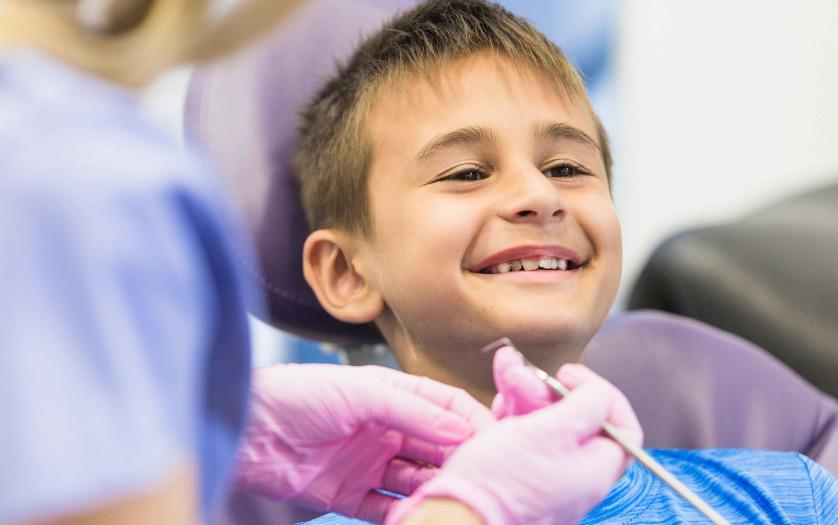 boy going through dental treatment in clinic