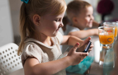 kid playing game with smartphone