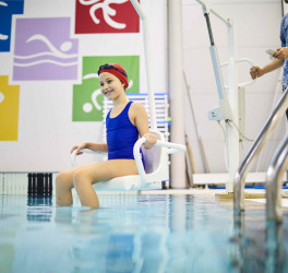 Rehabilitation of disabled girl in pool