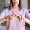 a woman learning sign language