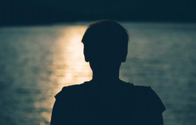 Silhouette of depressed sad