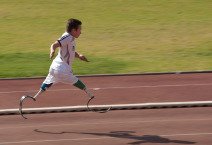 young disabled athlete running 100m sprint