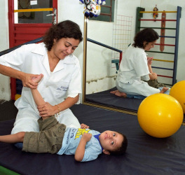 Female Therapist works with a child with disability