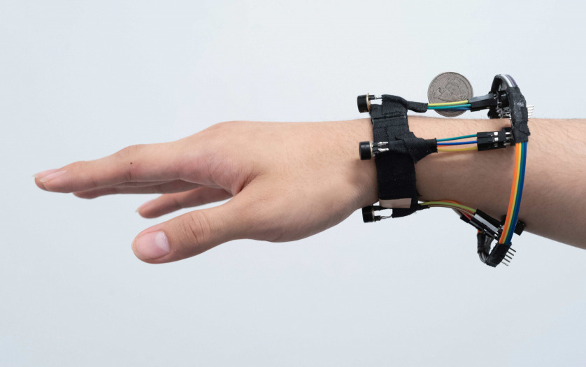 a person hand wearing the device