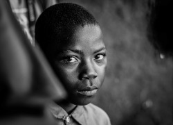 black and white image of an african boy