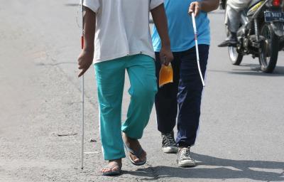 Blind people walking