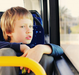autistic boy sitting in empty bus
