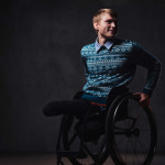 portrait of a man in wheelchair over grey background