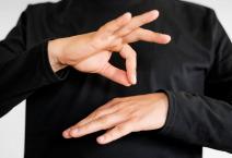 Close-up interpreter teaching sign language