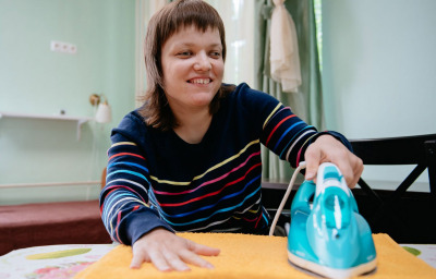 blind woman learning ironing
