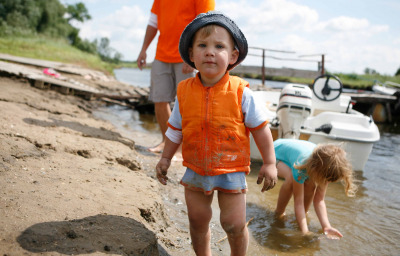 boy with autism with family at the river bank