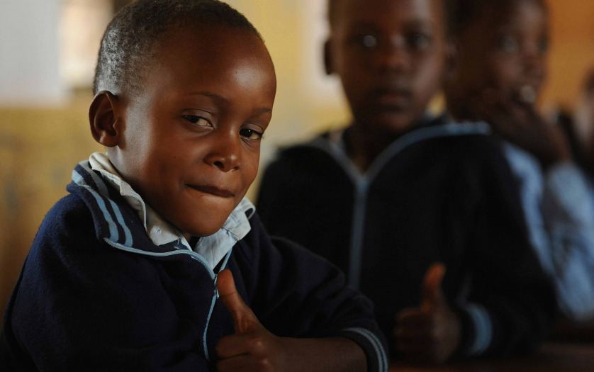 smiling african boy in the classroom