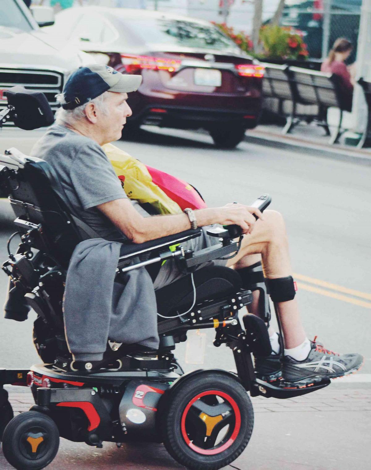 Man crossing road in power wheelchair
