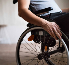 man in wheelchair at home