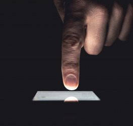 Close up of man's hands touching smart phone