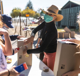 Women wearing mask and packing food
