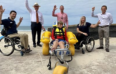 (L-R) Lachy Chapman, Spinal Life Australia, Mayor Mark Jamieson, Compass CEO David Dangerfield, Compass trainee Cole Kienzle (front, in beach wheelchair), Katie Hammond, Spinal Life Australia and Division 2 Councillor Terry Landsberg.