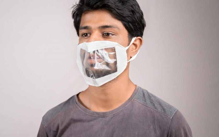 Young man with transparent face mask