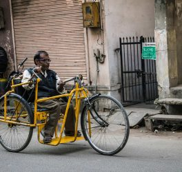 A disabled person riding a with Tricycle, Jaipur, India