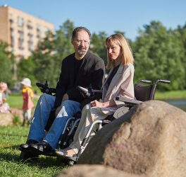 a photo of man and woman in wheelchair