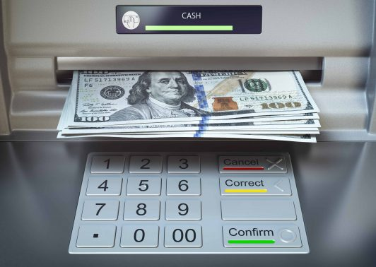 ATM machine and money. Withdrawing dollar banknotes