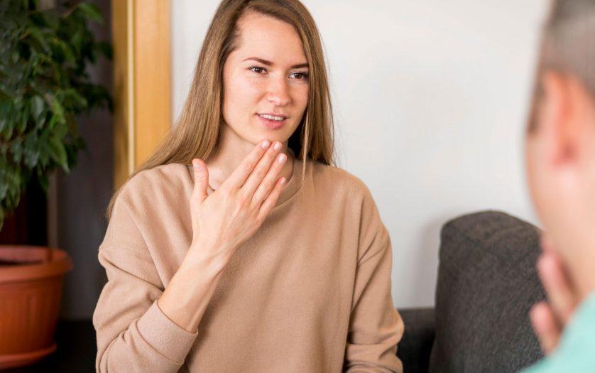 Deaf woman communicating through sign language