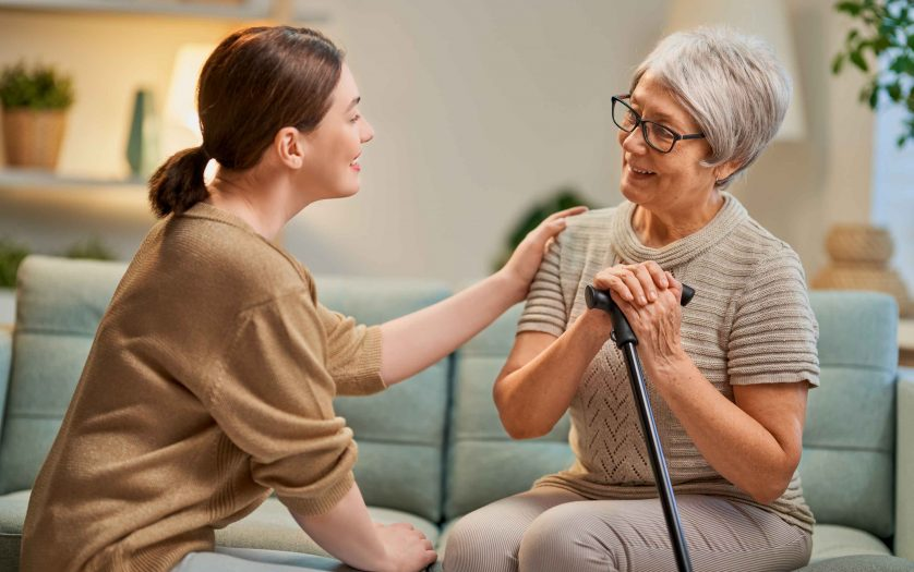 Elderly patient and caregiver spending time together