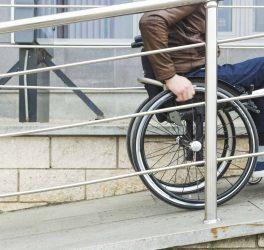 wheelchair user entering the building