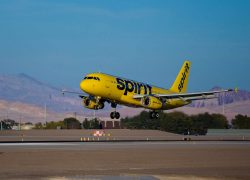 A Spirit Airlines Airbus aircraft landing at Las Vegas McCarran International Airport.