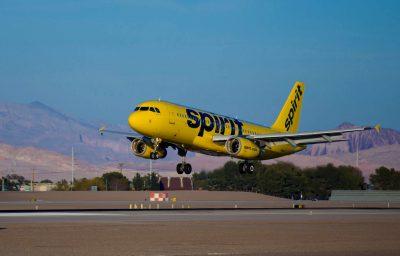 A Spirit Airlines Airbus aircraft landing at Las Vegas McCarran International Airport.