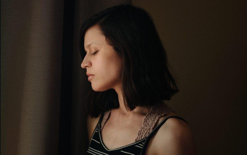 Depressed sad woman at home