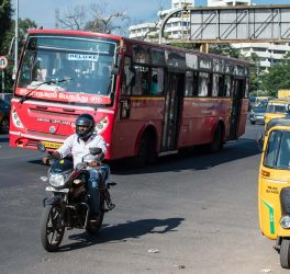 Traffic with public transport red bus in Chennai, India