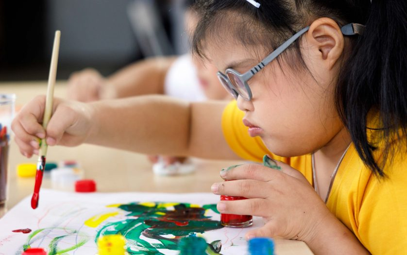 Girl with Down syndrome painting.