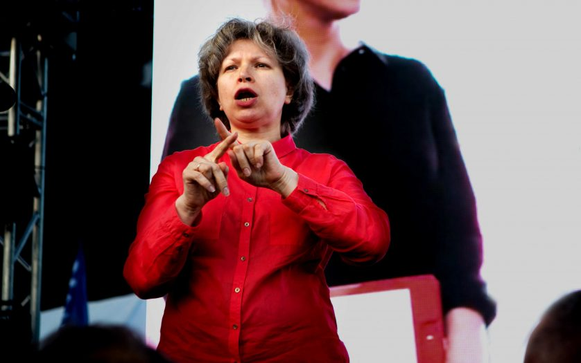 sign language interpreter works on the stage