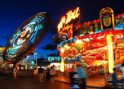 The glowing lights draw folks to the Boardwalk amusement park in Seaside Heights, New Jersey