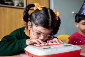 a blind girl using the braille device